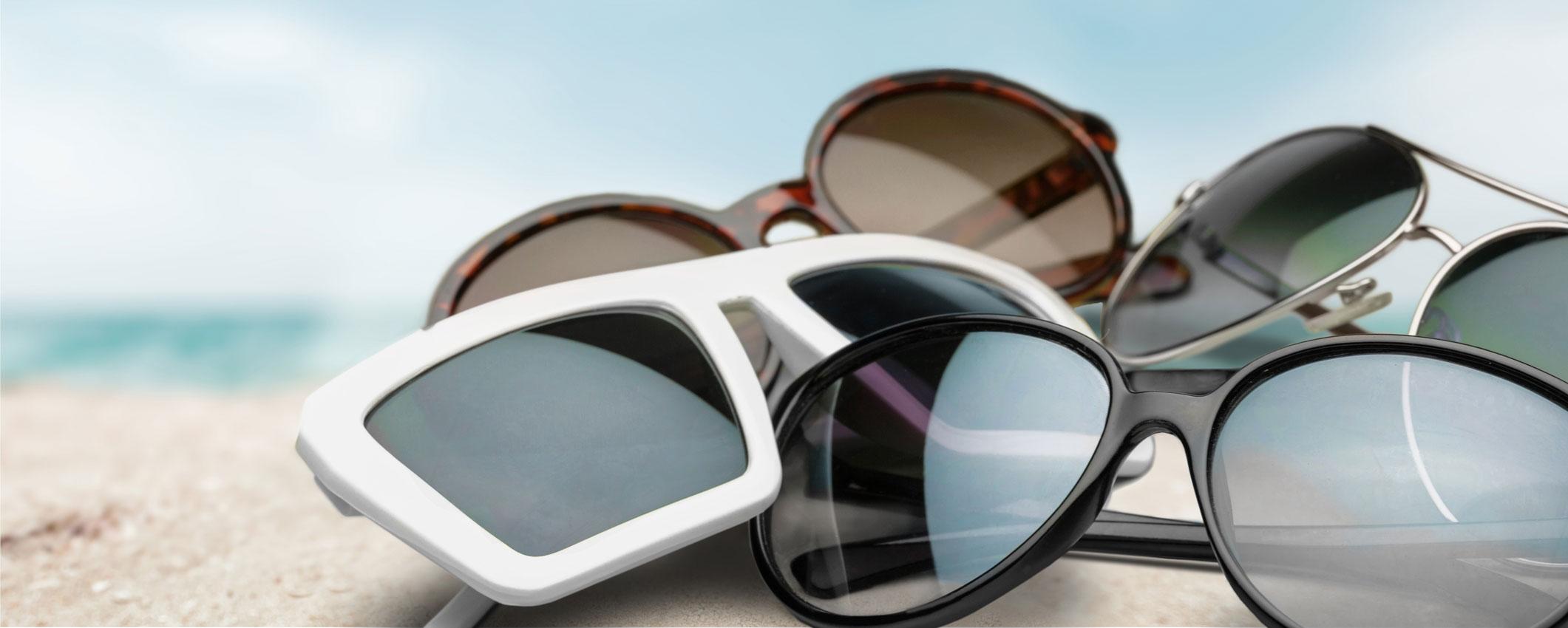 Sunglasses lying on the beach